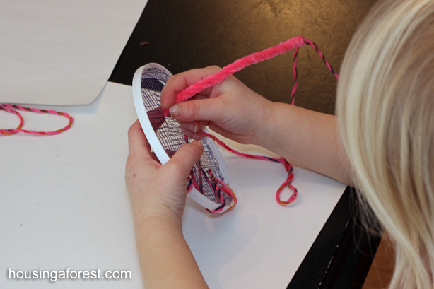 Simple toddler sewing activity using recycled materials - fine motor skills