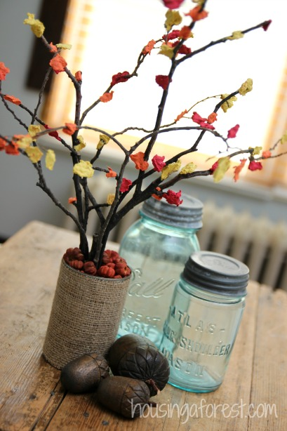 Fall centerpiece craft for kids housing a forest