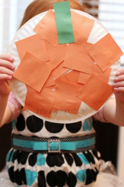 All you need is a paper plate, orange and green construction paper, scissors and glue.