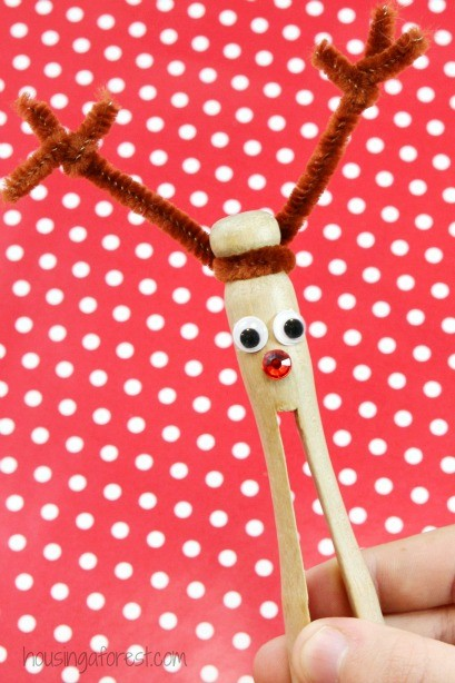 Clothespin reindeer ornament housing a forest for Christmas clothespin crafts