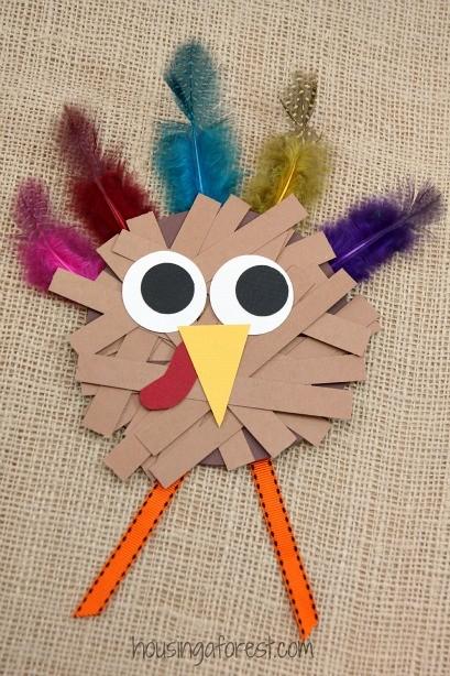 Paper strip turkey craft housing a forest for Thanksgiving turkey pattern craft