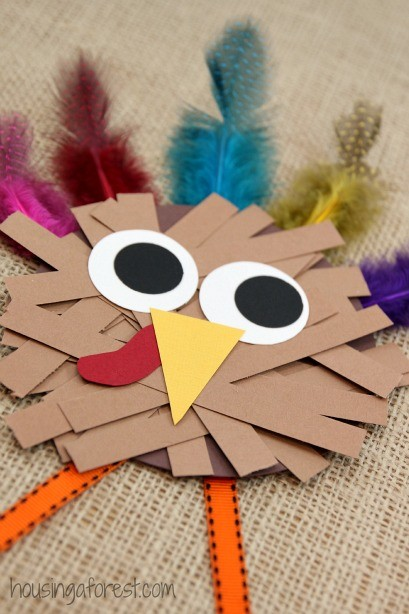Paper strip turkey craft housing a forest for Thanksgiving turkey arts and crafts
