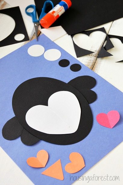 heart penguin craft for kids housing a forest