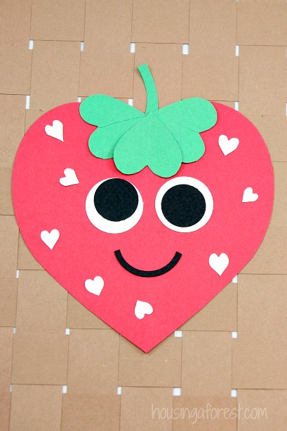Heart strawberry craft housing a forest for Valentine day crafts for kids